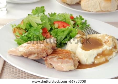 An elegant dinner of grilled boneless chicken thigh - stock photo