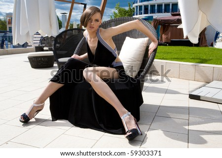 An elegant girl in a chair - stock photo