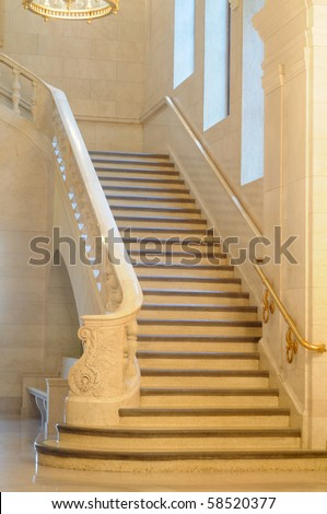An elegant marble staircase in a venerable public building - stock photo