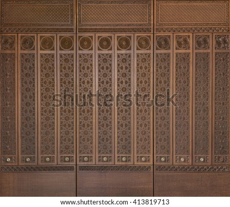 An elegant  middle eastern design engraved on wood. - stock photo