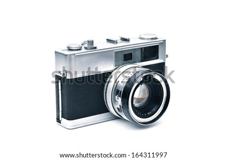An elegant retro range finder camera isolated in white - stock photo