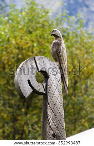 An element in the shape of a bird decorations of the ancient pagan wooden church in Caucasus  - stock photo