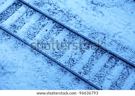 an elevated view of railway in winter time - stock photo