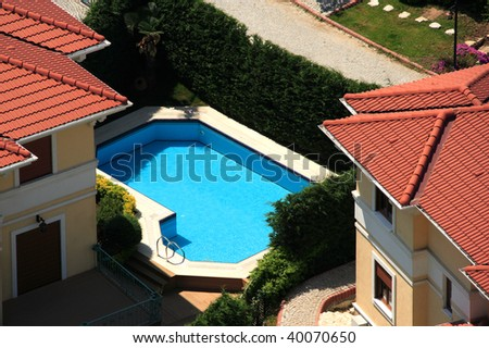 an elevated view of several houses and swimming-pool - stock photo