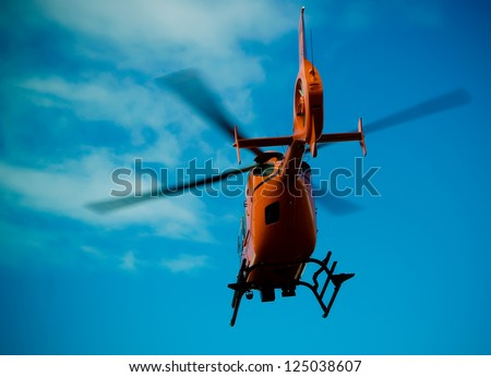 An emergency helicopter taking off. - stock photo