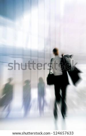 An employee returning to work. Motion blur. Urban scene. - stock photo
