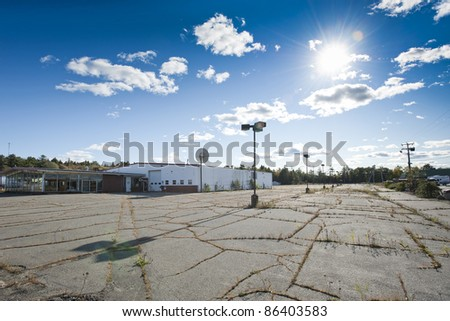 An empty car dealership gone out of business due to the bad economy - stock photo