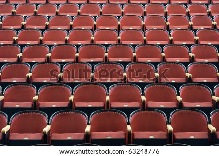 an Empty chairs in a concert hall - stock photo