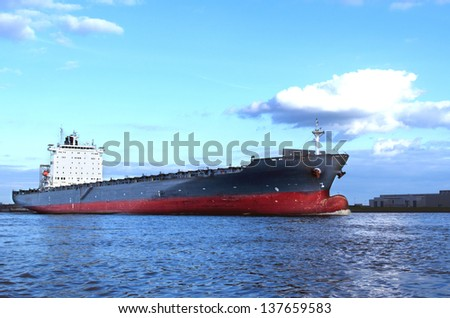 An empty container vessel leaving the harbor of Hamburg. - stock photo