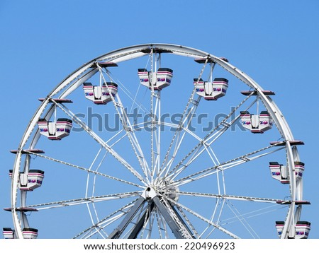 An empty ferris wheel in Maine on a blue sky day - stock photo