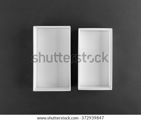 An empty gift white box on a black background - stock photo