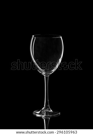An empty glass of wine, isolate on a black background - stock photo