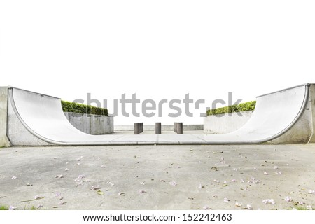 An empty halfpipe at public park isolated on white background with clipping path - stock photo