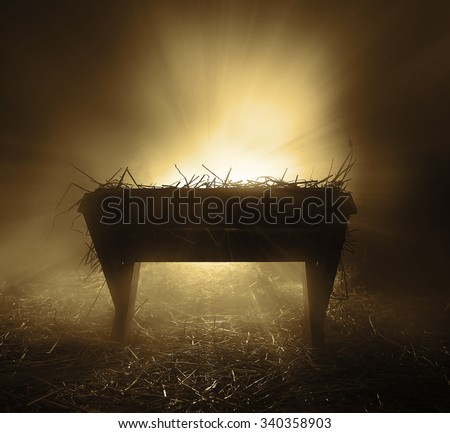 An empty manger at night with bright lights. - stock photo
