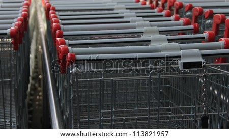 An empty metal shopping carts or Trolley - stock photo