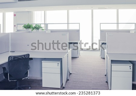 An empty office room and office table - stock photo