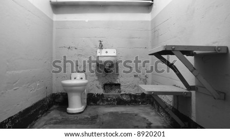 An empty prison cell at Alcatraz National Park with institutional green paint. This cell is only missing a bed but this shows how little room would be left in a typical jail cell. - stock photo