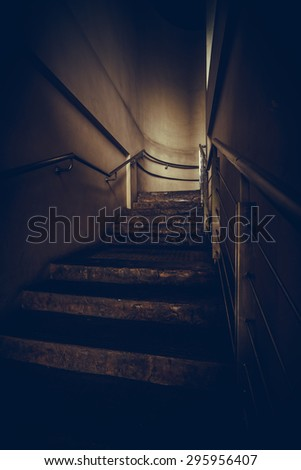 an empty stairwell with metal hand rail, vintage or retro tone - stock photo