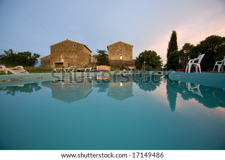 an empty swimming pool at sunset France - stock photo