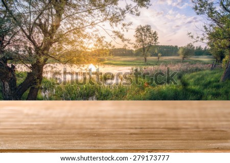 An empty table with natural background - stock photo