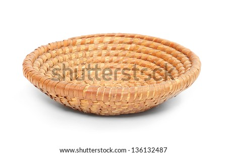 An empty wicker dish on white background.  Traditional rustic handmade product. - stock photo