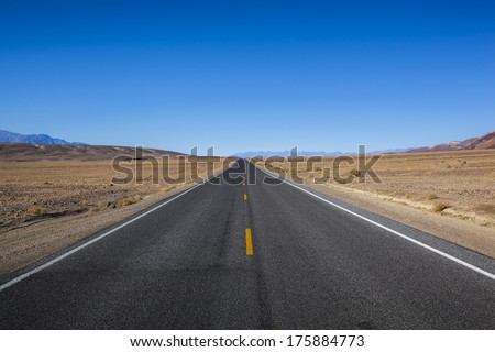 An endless road in Death Valley. - stock photo