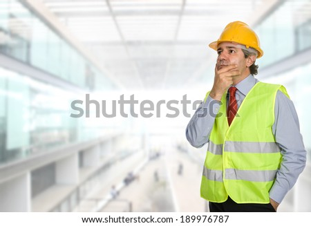 An engineer with yellow hat at the office - stock photo