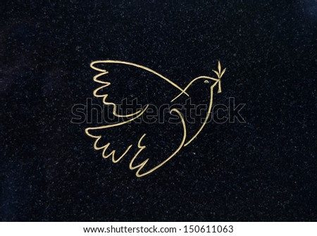 An Engraved Gold Dove Of Peace On A Grave In A Cemetery - stock photo