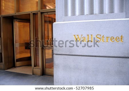 An entrance to an office building on Wall Street in New York City - stock photo