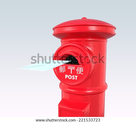 An envelope flying into a red vintage Japanese postbox - stock photo