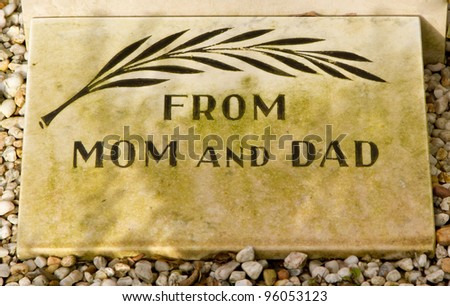 An epitaph on an old grave in Holland - stock photo