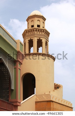 An example of Islamic architecture in a minaret at The Pearl residential development in Doha, Qatar. - stock photo