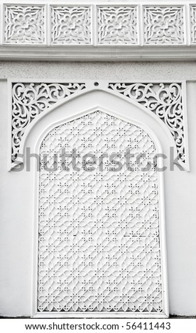 An example of Islamic mosque design cast in concrete on a building in Terengganu, Malaysia. - stock photo