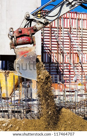 an excavator bucket earth at a construction site. - stock photo