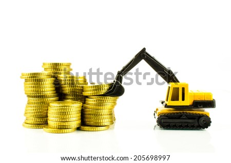an excavator standing on euro banknotes. symbolic photo for costs, revenues and subsidies in the construction industry and the construction industry  - stock photo
