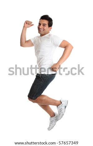 An excited jumping leaping man wearing casual clothes - success victory triumph.  Joyful young person smiling as he celebrates something. - stock photo