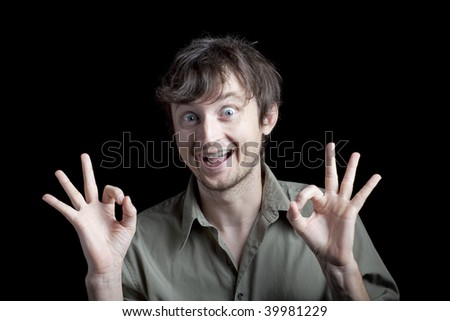 An excited man making a hand gesture - stock photo