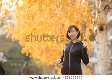 An exercising young woman. - stock photo