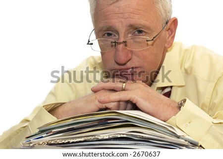 An exhausted businessman has had too much of his paperwork. - stock photo