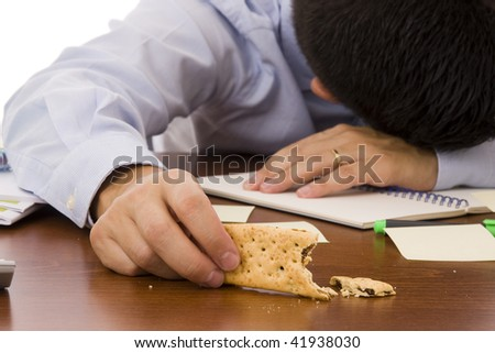 An exhausted worker sleeping at office - Focus on the cracker - stock photo