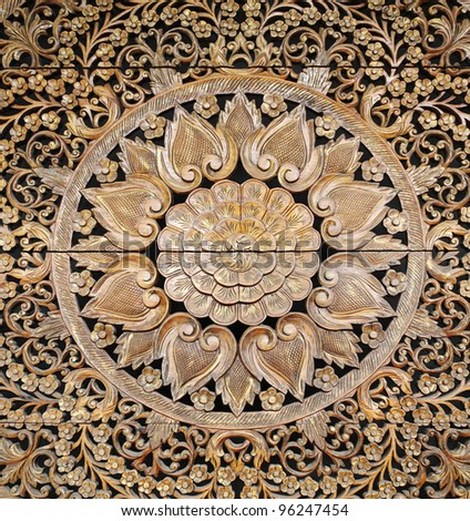 An exotic Javanese tribal wooden floral carving decorative panel for textural background. - stock photo