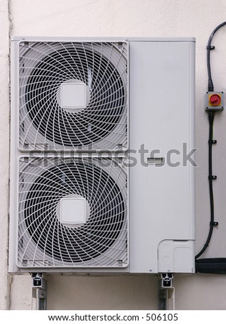 An external air conditioning exhaust unit mounted on a wall. - stock photo