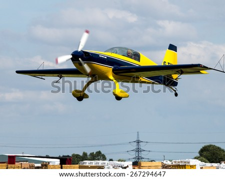 an Extra 200 aerobatic sport aircraft at Breighton airfield,Yorkshire,UK.taken 14/07/2013 - stock photo