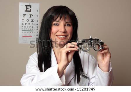 An eye doctor holding a pair of eye test trial  frames - stock photo