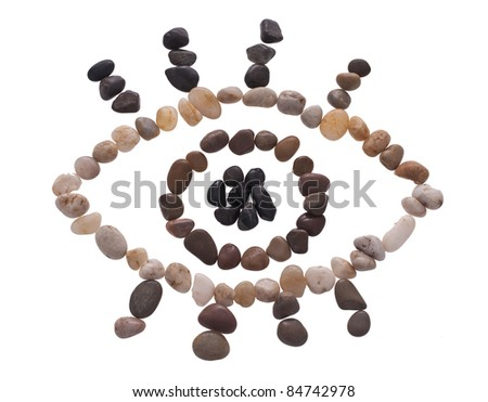 An eye made out of beach pebbles isolated on the white - stock photo