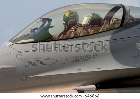 An F-16 pilot prepares to taxi out to the runway for take-off, at the 50th Anniversary Miramar Air Show, California. - stock photo