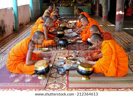 AN GIANG, VIET NAM - AUG 16,2014: Khmer monks of Hynayana having breakfast at a pagoda at An Giang province, Southern of Vietnam. - stock photo