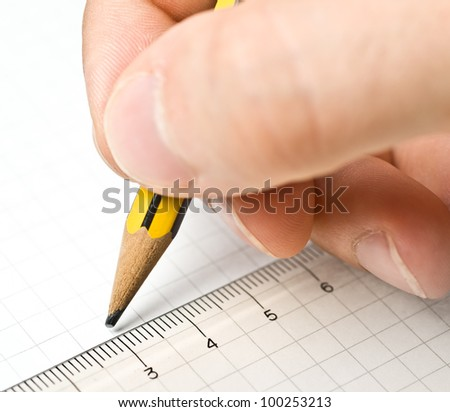 An hand who writes in a blank paper sheet - stock photo