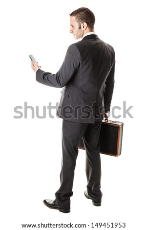 an handsome businessman with a smartphone isolated over a white background - stock photo