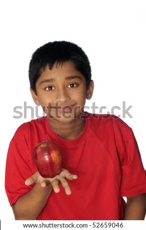 An handsome Indian kid eating apple a day - stock photo